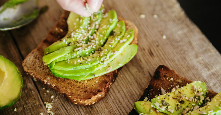Photo showing two slices of avocado toast